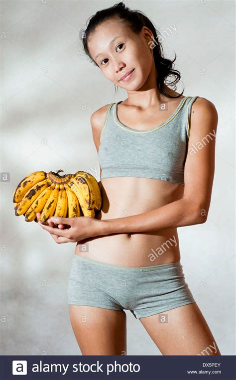 young Asian body shape model with bananas in studio